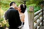 Bride and groom kissing outdoors in public garden, in Autumn, Ontario, Canada Stock Photo - Premium Rights-Managed, Artist: Ikonica, Code: 700-07199869