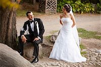 special moment - Bride and groom outdoors in public garden, smiling and looking at each other, in Autumn, Ontario, Canada Stock Photo - Premium Rights-Managednull, Code: 700-07199873