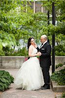 special moment - Portrait of bride and groom standing outdoors in garden, Ontario, Canada Stock Photo - Premium Rights-Managednull, Code: 700-07199876