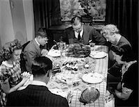 1940s THREE GENERATION FAMILY SAYING GRACE THANKSGIVING DINNER Stock Photo - Premium Rights-Managednull, Code: 846-07200061