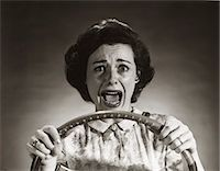 people in panic - 1950s SCREAMING FRIGHTENED WOMAN HOLDING ON TO STEERING WHEEL DRIVING CAR Stock Photo - Premium Rights-Managednull, Code: 846-07200072
