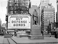 1940s BUY DEFENSE BONDS BILLBOARD AT STATUE OF FATHER DUFFY OF THE FIGHTING 69th OF WORLD WAR I AT TIMES SQUARE NEW YORK CITY Stock Photo - Premium Rights-Managednull, Code: 846-07200137