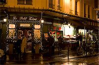 food stalls - People shelter from rain at night on street corner outside traditional Le Petit Zinc Restaurant, Left Bank, Paris, France Stock Photo - Premium Rights-Managednull, Code: 841-07201786