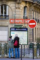 planner - Tourists on foot study Metropolitain subway map for the Paris Metro in Rue du Bac, Left Bank, Paris, France Stock Photo - Premium Rights-Managednull, Code: 841-07201789