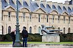 Visitors admire bronze sculpture statue of reclining nude by Maillol in Jardin in front of the Louvre in the Jardin des Tuileries, Central Paris, France