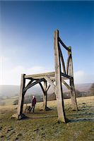 Dog walker gazes up at the Giants Chair sculpture in Dartmoor National Park, Devon, England, United Kingdom, Europe Stock Photo - Premium Rights-Managed, Artist: Robert Hardin