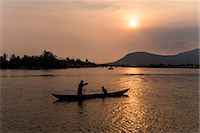 Father and son fishing on Kampong Bay River at sunset, Kampot, Cambodia, Indochina, Southeast Asia, Asia Stock Photo - Premium Rights-Managednull, Code: 841-07202638