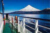 Close-up of tour boat on Cruce Andino, looking toward Osorno Volcano, Lake Todos los Santos, Parque Nacional Vicente Perez Rosales, Patagonia, Chile Stock Photo - Premium Rights-Managednull, Code: 700-07202720