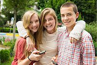 farm phone - Three young people, two girls and a boy, posing and taking selfy photographs. Stock Photo - Premium Royalty-Freenull, Code: 6118-07203277