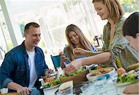 A family party around a table in a cafe. Adults and children. Stock Photo - Premium Royalty-Freenull, Code: 6118-07203588