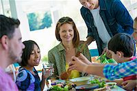 A family party around a table in a cafe. Adults and children. Stock Photo - Premium Royalty-Freenull, Code: 6118-07203591