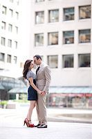 Portrait of couple standing in city courtyard, Toronto, Ontario, Canada Stock Photo - Premium Rights-Managednull, Code: 700-07203955