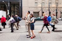 Couple standing on sidewalk on busy, city street, Toronto, Ontario, Canada Stock Photo - Premium Rights-Managednull, Code: 700-07203959