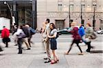 Couple standing on sidewalk on busy, city street, Toronto, Ontario, Canada Stock Photo - Premium Rights-Managed, Artist: Ikonica, Code: 700-07203959