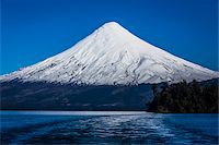 snow capped - Scenic view of Todos los Santos Lake and Osorno Volcano, Parque Nacional Vicente Perez Rosales, Patagonia, Chile Stock Photo - Premium Rights-Managednull, Code: 700-07203983