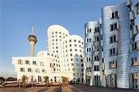 Rheinturm tower and Gehry Haus building, Medienhafen, Dusseldorf, North Rhine-Westphalia, Germany, Europe Stock Photo - Premium Rights-Managednull, Code: 841-07204578