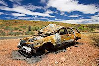 Burnt-out car wreck on road from Alice Springs, Namatjira Drive, Northern Territory, Australia Stock Photo - Premium Rights-Managed, Artist: Robert Harding Image