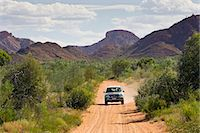 Four-wheel-drive vehicle on the Mereenie-Watarrka Road,  Gosse Bluff, Red Centre, Australia Stock Photo - Premium Rights-Managednull, Code: 841-07204989