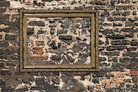 Gilded wooden frame over ruined brick wall Stock Photo - Royalty-Freenull, Code: 400-07209439