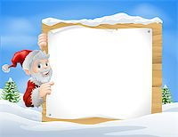 Santa Christmas sign in the centre of a winter snow scene with snow capped trees Stock Photo - Royalty-Freenull, Code: 400-07215505