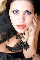 Close-up portrait of a beautiful young brunette Stock Photo - Royalty-Freenull, Code: 400-07218511