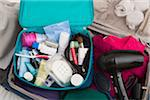 Women's Toiletry Travel Bag in Packed Suitcase