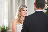 special moment - Close-up portrait of Bride with backview of Groom, looking at each other, Canada Stock Photo - Premium Rights-Managednull, Code: 700-07232323