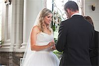 ring hand woman - Bride and Groom exchanging vows and rings at Wedding ceremony, Canada Stock Photo - Premium Rights-Managednull, Code: 700-07232325