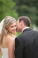 Close-up of Groom kissing Bride on cheek on Wedding Day outdoors, Canada Stock Photo - Premium Rights-Managednull, Code: 700-07232333