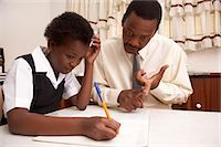 Father helping daughter with homework Stock Photo - Premium Royalty-Freenull, Code: 6110-07233632