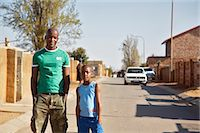 Father and son standing on street Stock Photo - Premium Royalty-Freenull, Code: 6110-07233635