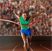 finish line - Young woman sprinting through winners tape in stadium Stock Photo - Premium Royalty-Freenull, Code: 614-07234797