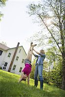 fitness   mature woman - A family summer gathering at a farm. A shared meal, a homecoming. Stock Photo - Premium Royalty-Freenull, Code: 6118-07235050