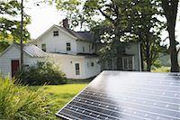 solar panel usa - A solar panel in a farmhouse garden. Stock Photo - Premium Royalty-Freenull, Code: 6118-07235245