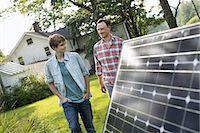 solar panel usa - Two people walking towards a farmhouse garden. Stock Photo - Premium Royalty-Freenull, Code: 6118-07235249