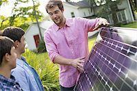 solar panel usa - Two people walking towards a farmhouse garden. Stock Photo - Premium Royalty-Freenull, Code: 6118-07235253
