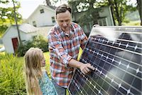 solar panel usa - A man and a young girl looking at a solar panel in a garden. Stock Photo - Premium Royalty-Freenull, Code: 6118-07235254