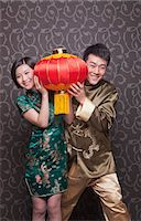 Young Couple Holding Chinese Lantern in Traditional Clothing Stock Photo - Premium Royalty-Freenull, Code: 6116-07235542