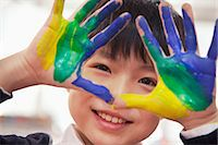 finger painting - Portrait of smiling schoolboy finger painting, close up on hands Stock Photo - Premium Royalty-Freenull, Code: 6116-07235679