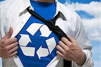 superhero - Businessman with open short revealing shirt with recycling symbol underneath Stock Photo - Premium Royalty-Freenull, Code: 6116-07236201