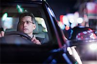 Businessman driving at night in the city Stock Photo - Premium Royalty-Freenull, Code: 6116-07236493