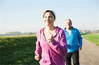 Couple Jogging Outdoors, Mannheim, Baden-Wurttemberg, Germany Stock Photo - Premium Royalty-Freenull, Code: 600-07237891