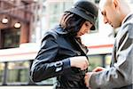 Man Helping with Belt of Woman's Coat, Toronto, Ontario, Canada Stock Photo - Premium Rights-Managed, Artist: Ikonica, Code: 700-07237830