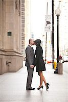 Full Length Portrait of Couple Kissing Outdoors on City Sidewalk, Toronto, Ontario, Canada Stock Photo - Premium Rights-Managed, Artist: Ikonica, Code: 700-07237831