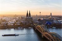 Elevated View of Hohenzollern Railroad Bridge over River Rhine by Cologne Cathedral at Sunset, North Rhine-Westphalia, Germany Stock Photo - Premium Royalty-Freenull, Code: 600-07238074