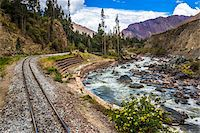 Train rails beside river on scenic journey through the Sacred Valley of the Incas in the Andes mountains, Peru Stock Photo - Premium Rights-Managed, Artist: R. Ian Lloyd, Code: 700-07238025