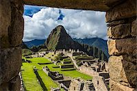 Looking through stone, structural opening at overview of Machu Picchu, Peru Stock Photo - Premium Rights-Managednull, Code: 700-07238059