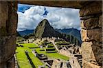 Looking through stone, structural opening at overview of Machu Picchu, Peru Stock Photo - Premium Rights-Managed, Artist: R. Ian Lloyd, Code: 700-07238059