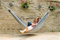 Portrait of mother and daughter in hammock Stock Photo - Premium Royalty-Freenull, Code: 649-07238625