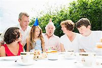 Family celebrating grandfather's birthday Stock Photo - Premium Royalty-Freenull, Code: 649-07238647